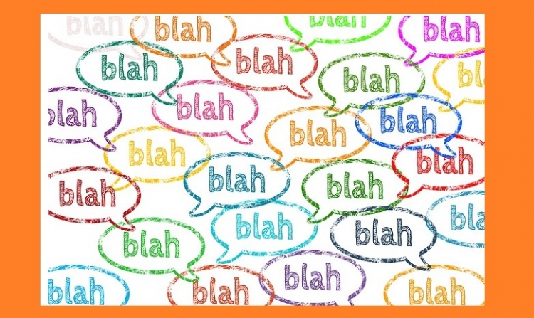 text balloons with blah blah blah written in it in different colors.